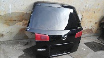 Дверь багажника Mazda Demio