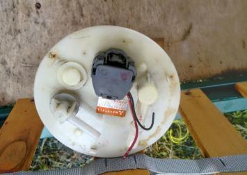 Насос топливный электрич. Mitsubishi Lanser 03-08г MR497413