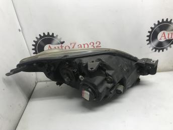 Блок фара левая Mazda Demio