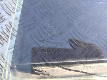 Стекло задней левой двери Ford Focus 1 1092949