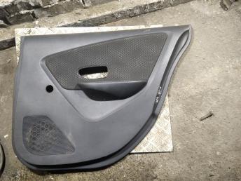 Обшивка двери Nissan Almera G15