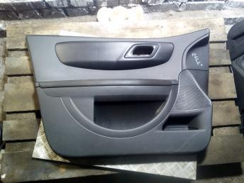 Обшивка двери Citroen C4